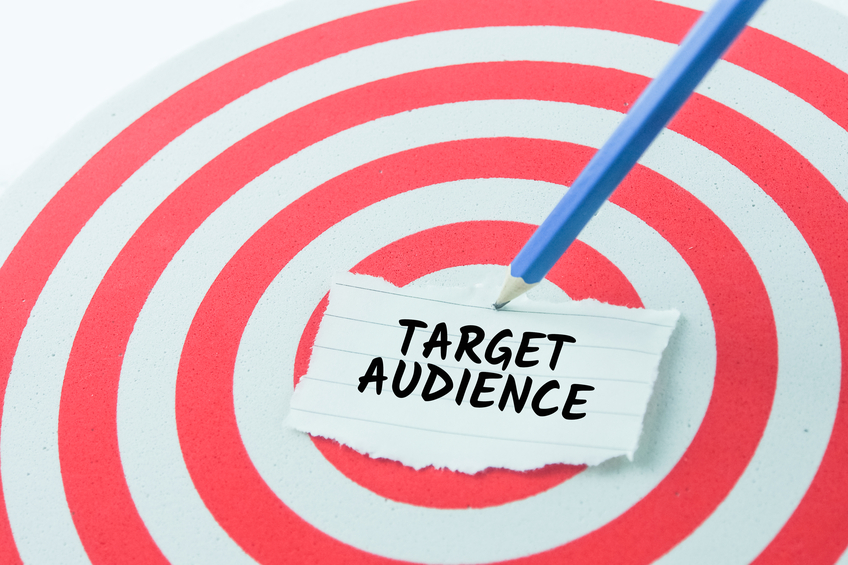 word target audience on note paper stick on dart board with pencil,target concept